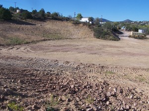 Site with tailings removed, followed by backfilling and re-grading (10/2/13)