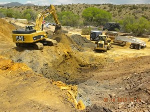 Photo shows excavation and removal of tailings from the site